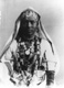 Click to see details of an ethiopian woman wearing elaborate...