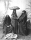 Click to see details of three veiled women dressed in dark...