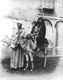 Click to see details of a veiled woman and a child on a donkey...