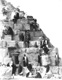 Click to see details of tourists climbing the pyramid of...