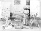 Click to see details of two men spinning silk.